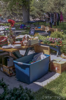 Cramer Imaging's photograph of a springtime yard sale with items for sale on display