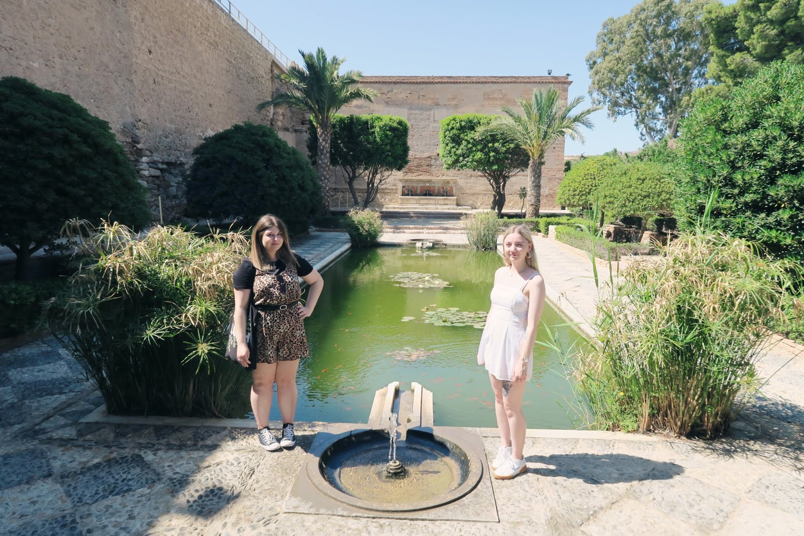 Standing by a pool inside Almeria Alcazaba