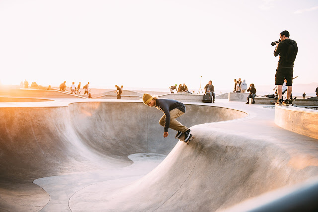 Young man skateboarding at skate park