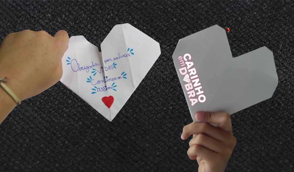 """O origami é o ponto de partida do projeto """"Carinho em Dobra"""", que busca, através de oficinas em instituições de saúde, escolas e eventos comunitários e da doação de livros do projeto, promover a arte milenar de dobradura em papel como forma de conectar e aproximar pessoas."""