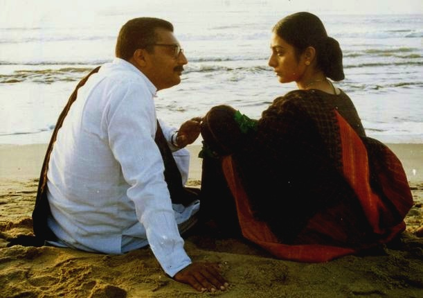 A Still from Mani Ratnam's Iruvar, Tabu with Prakash Raj, on the beach