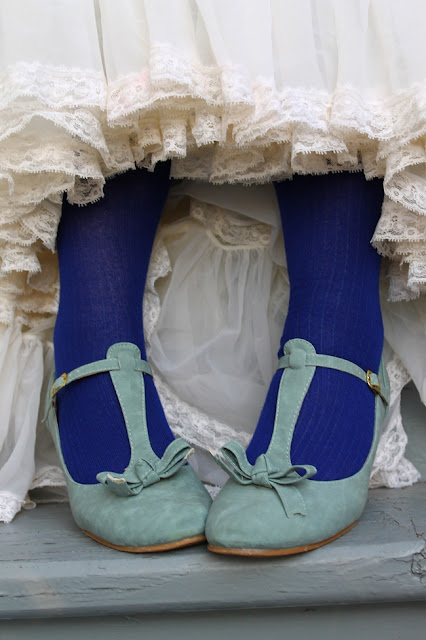 vintage petticoat with blue stocking socks and blue t strap shoes with bow