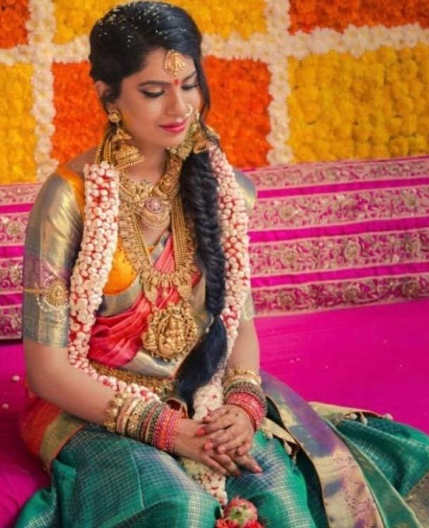 Bride in Heavy Nakshi Jhumkas