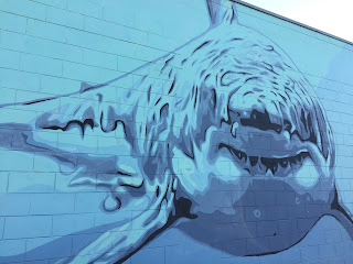 mural of shark on fish store wall