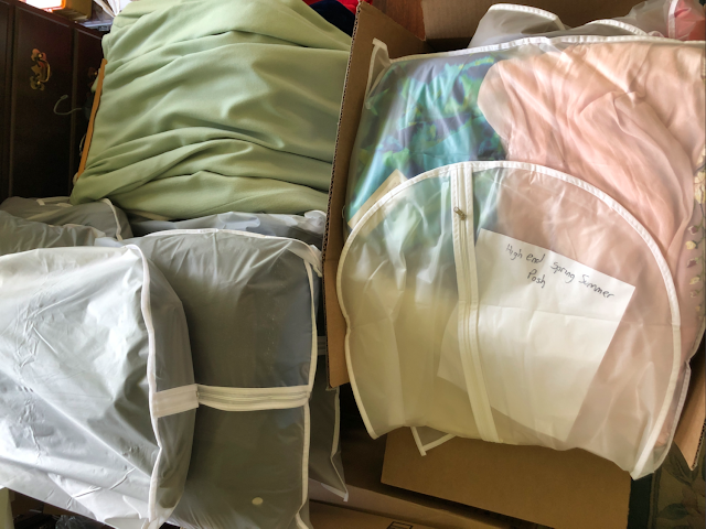 Bagged piles of women's clothing to donate or sell