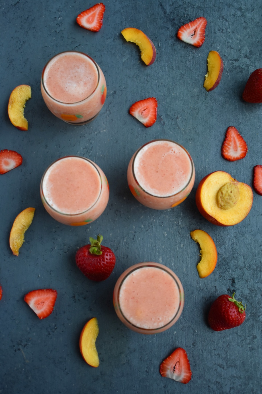 Strawberry Peach Wine Slushies are super refreshing and are perfect for easy entertaining with only 4 ingredients and take 2 minutes to make! www.nutritionistreviews.com