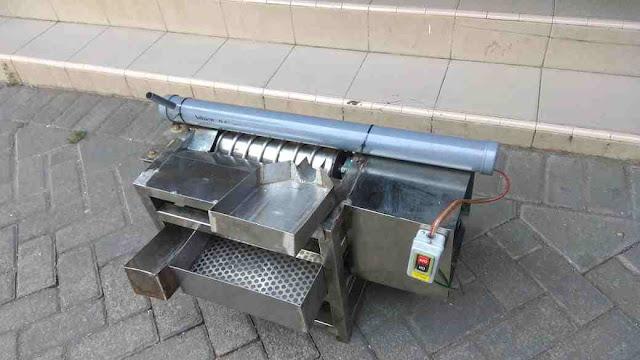 Mesin pengupas dan pembersih kulit telur