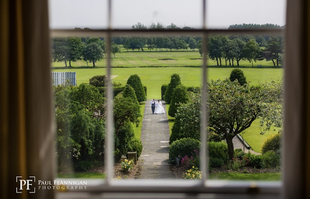 wedding photo bride and groom out the window