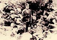 Ustasha guard posing amid a pile of bodies