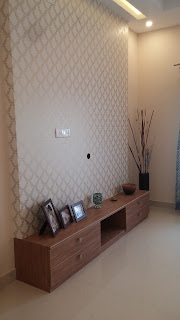 TV Unit with wall papered back panel to hide the wires