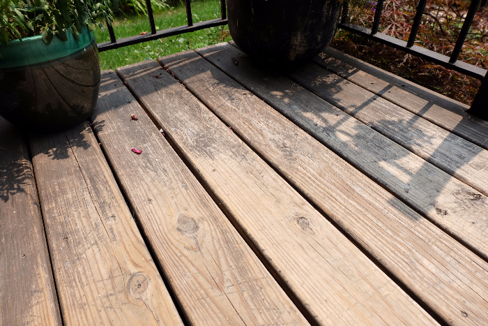 showing how porch stain completely wore away