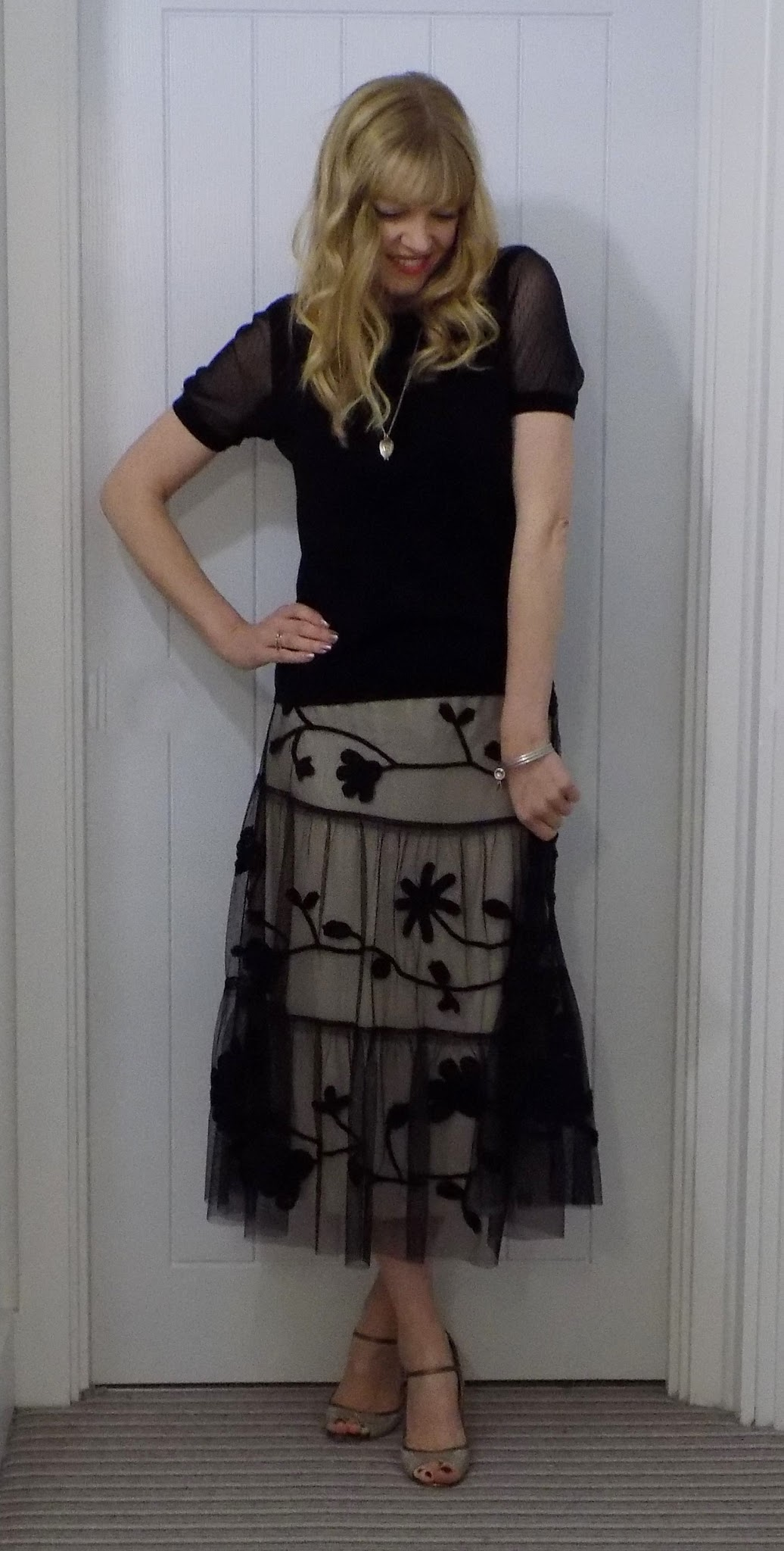 Coast lace overlay midi skirt with black sheer-sleeved top