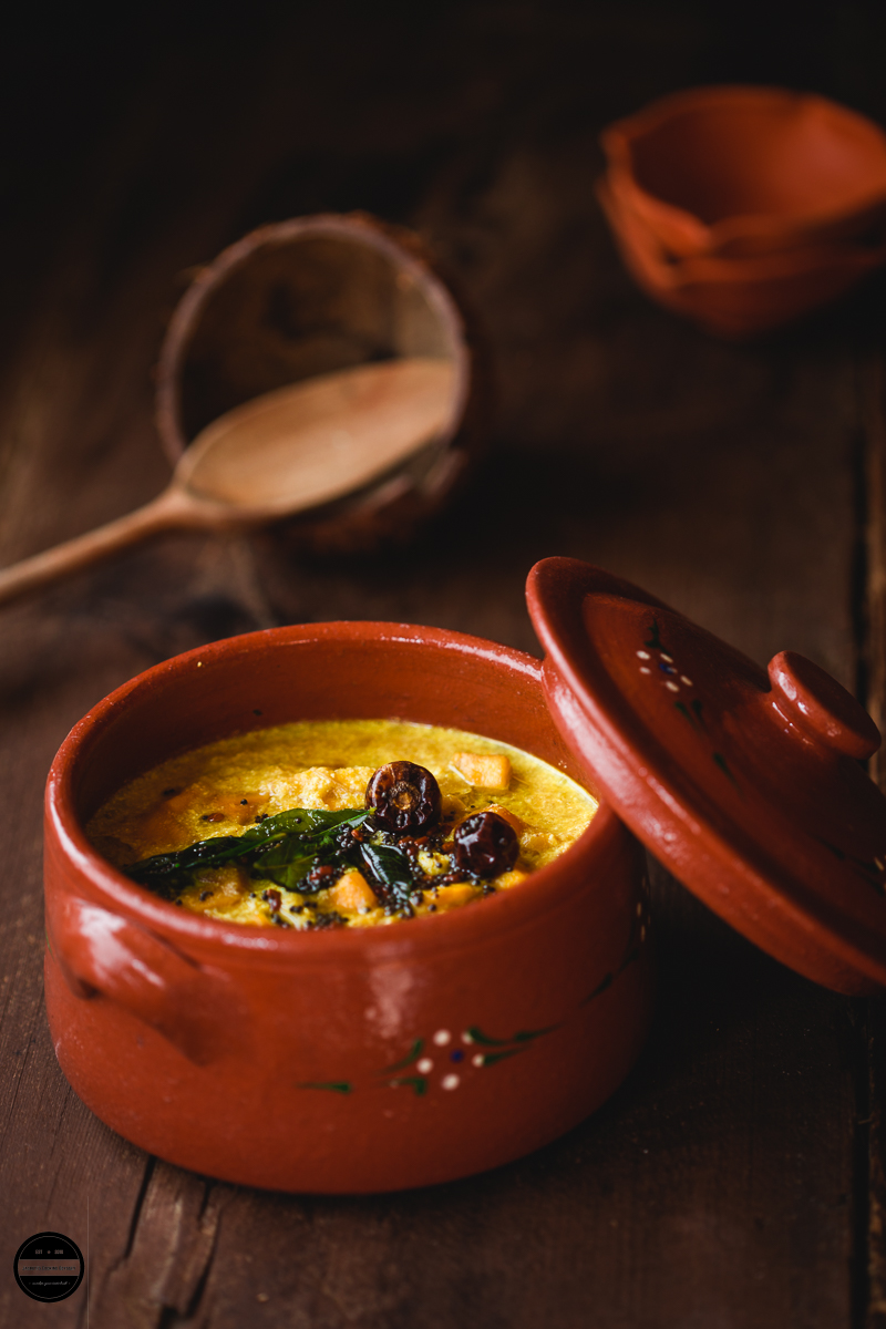 Mambazha Pulissery Kerala Style, prepared with ripe mangoes with basic spices and simmered in yogurt and coconut gravy.