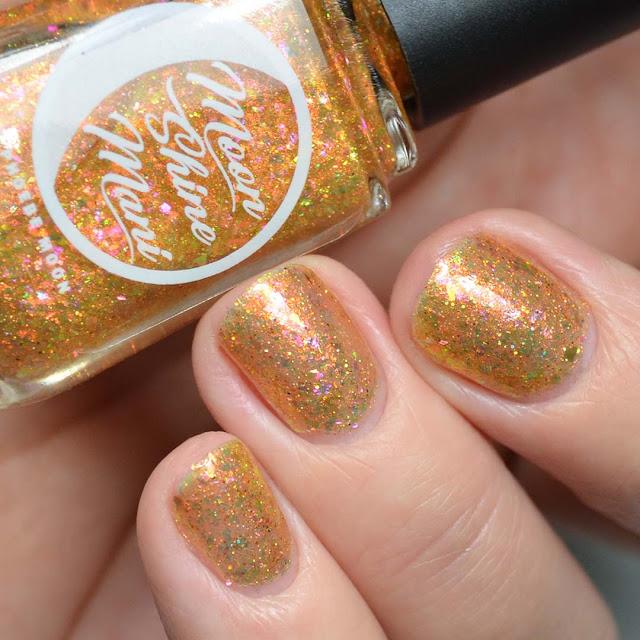 gold flakie nail polish swatch