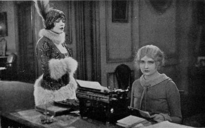 "Alathea (Harriet Hammond) realizes that Suzette (Renee Adoree) is the only woman that stands between her and the love of Sir Nicholas (Lew Cody). (A scene from Elinor Glyn's production ""Man and Maid"" for Metro-Goldwyn-Mayer)"