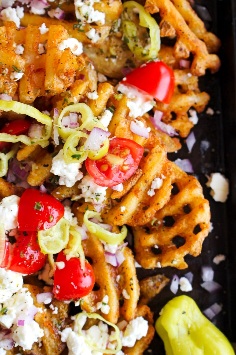 Top view closeup of Greek Waffle Fries on a dark sheet pan.