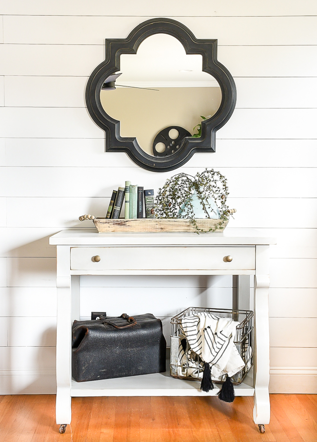 Gray painted console table with dark antique wax