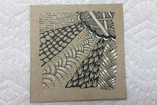 Tan square with Zentangle design in black ink with white accents
