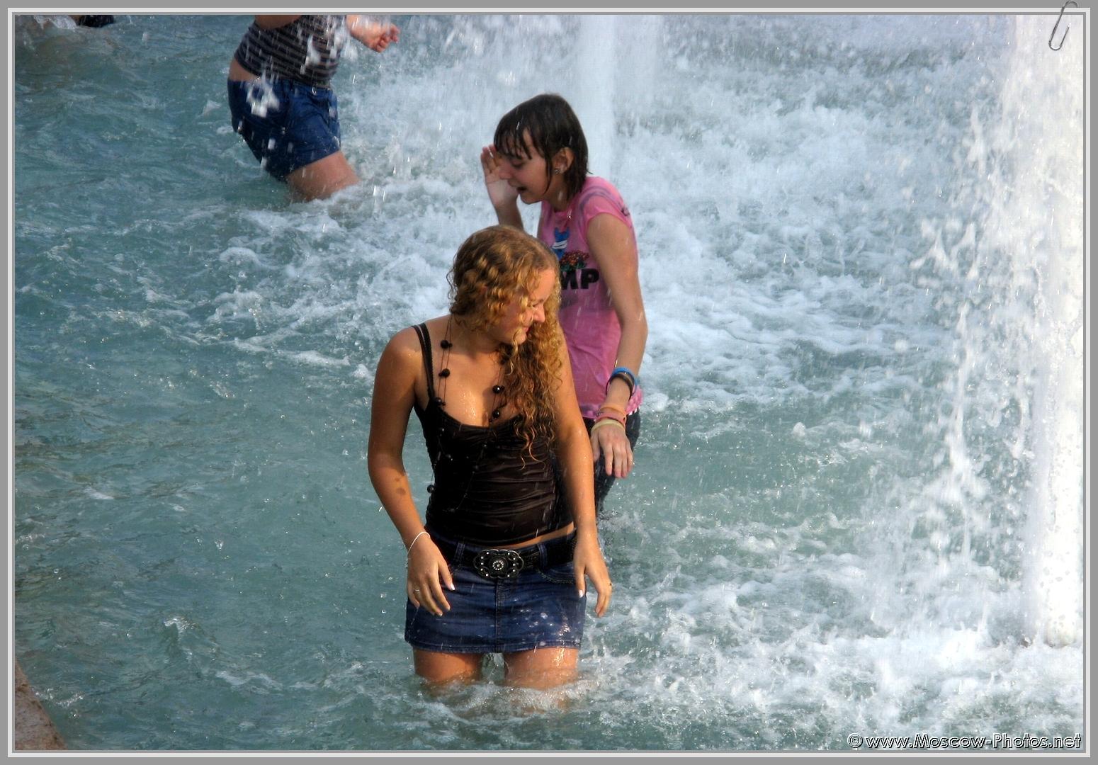 Girls enjoy the fountain