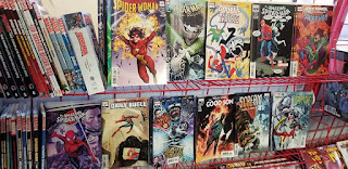 Spider Man comics on a red wire shelf at Acme Comics in Sioux City