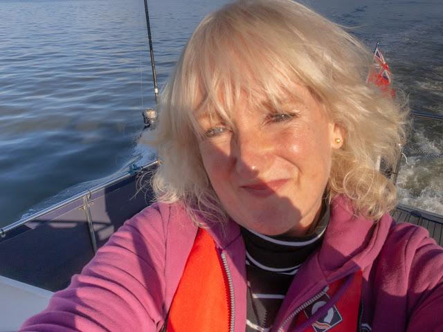 Photo of Me enjoying the sunshine on Ravensdale's aft deck