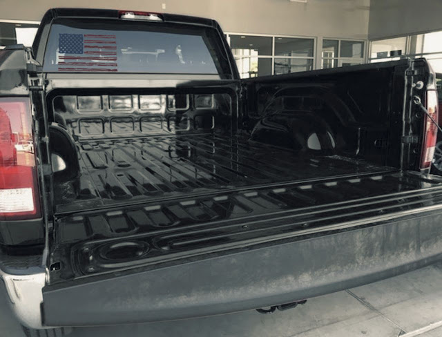 distressed-American-flag-decal-on-window-black-ram-1500-with-tailgate-opened