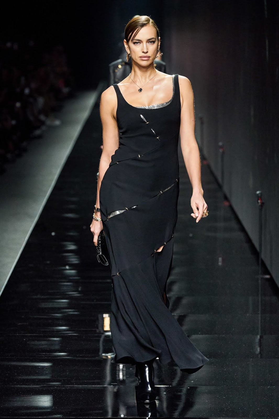 Irina Shayk sashayed down the Versace Fall/Winter 2020 Runway in a sultry black dress