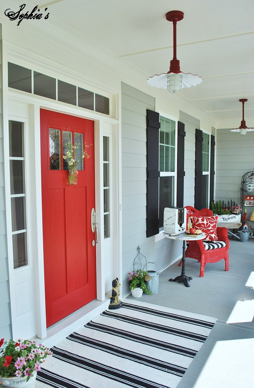 Sophias Farmhouse Style Front Porch With Pops Of Red