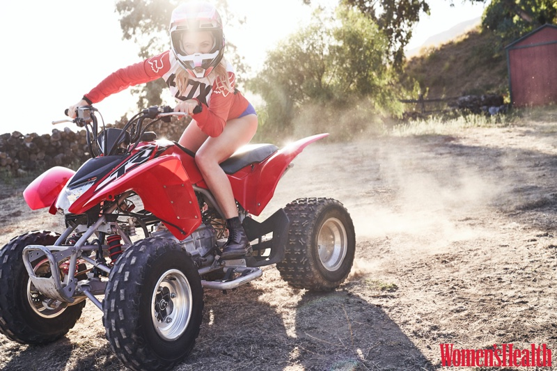 Riding a 4-wheeler, Kate Hudson wears Fox Racing jersey and helmet, Jade Swim bottom and Dr. Martens boots
