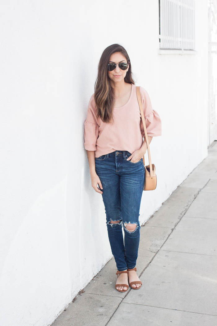 casual coral tee and ripped jeans