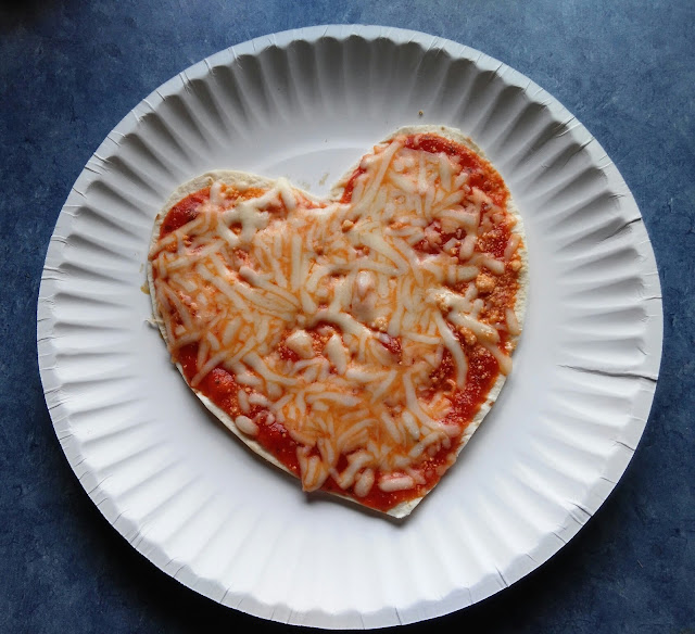 Mini heart shaped pizza for Valentine's Day.
