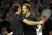 Andy and Jamie Murray dig deep to keep defence alive with crucial doubles victory