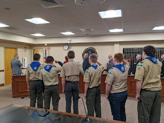 "Boy scouts from Troop 126 lead the overflow crowd at the Town Council meeting in the ""Pledge of Allegiance"""
