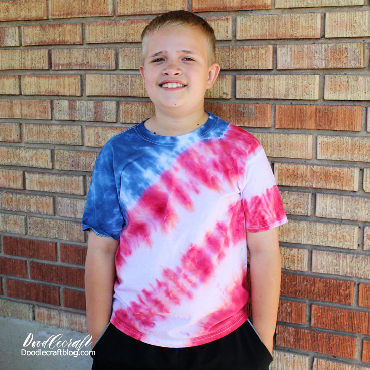 Red white and blue shirt tie dyed with stripes and a blue sleeve and collar.