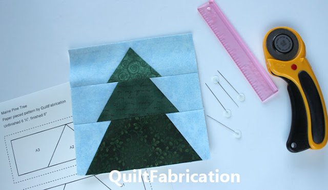 green pine tree on blue quilt block
