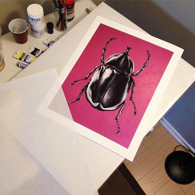 beetle print on pink background