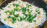 Poured green scallions (spring onions) over Chicken fried rice