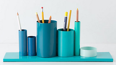 blue pencil holder with six sections of various heights