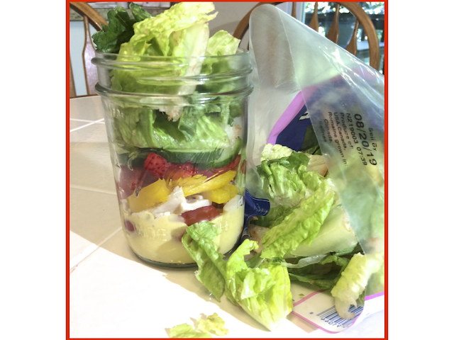 Add the lettuce to the very top of the mason jars.