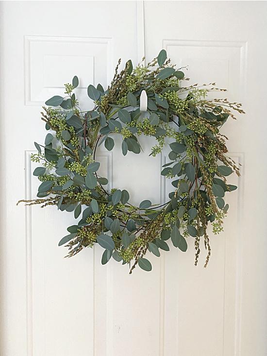 eucalyptus wreath on white door