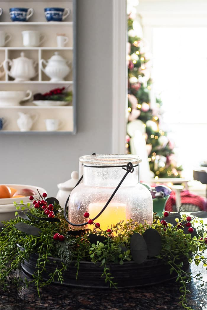 Christmas decorated hurricane in cozy kitchen
