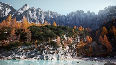 Precioso paisaje con montañas, nieve, arboles y mar