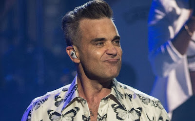 Robbie Williams song was inspired by his paranormal experiences planet-today.com
