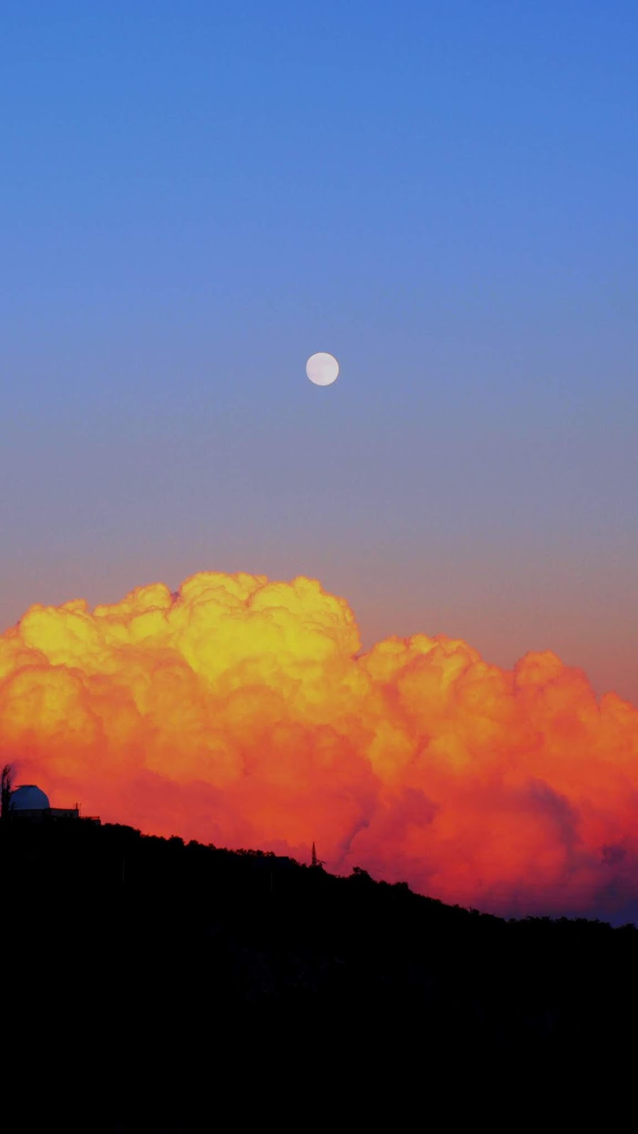 moon in cloudy sunset