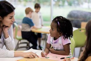 photo of child with art sub teacher