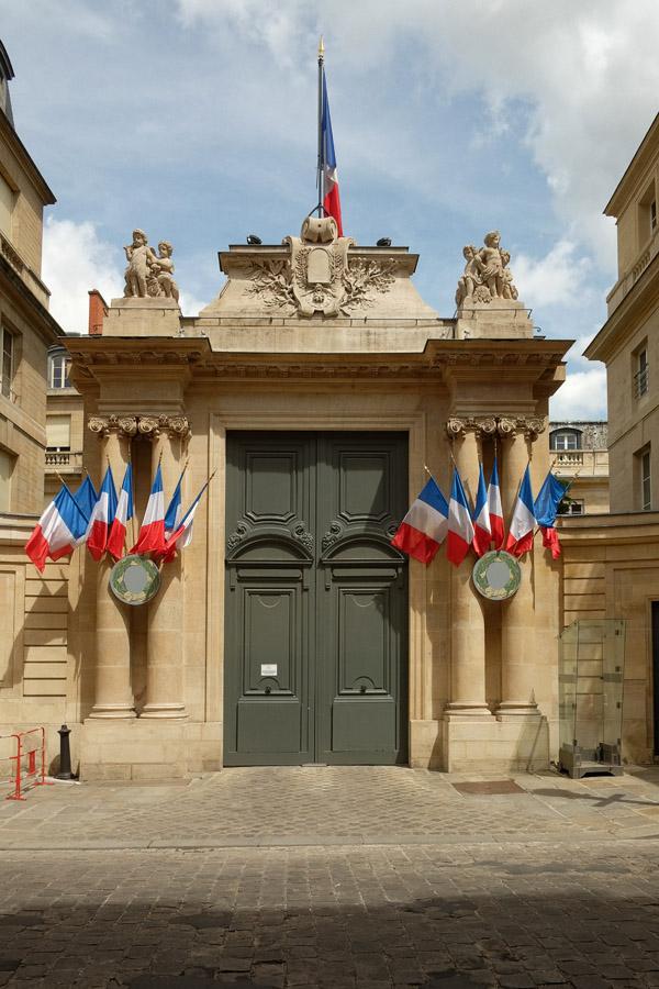 A gateway festooned with French flags on Rue de l'Université. Paris photos by Kent Johnson for Street Fashion Sydney.