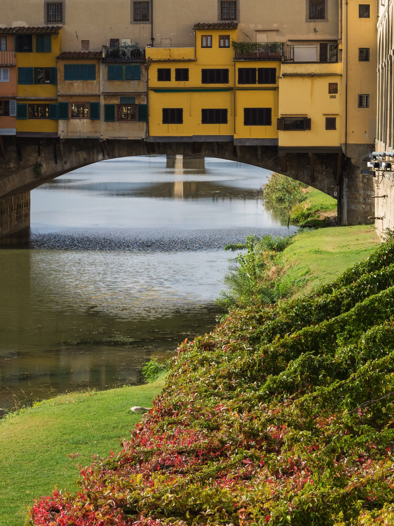 A close up of Ponte Vecchio taken along the embankment of the river Arno.