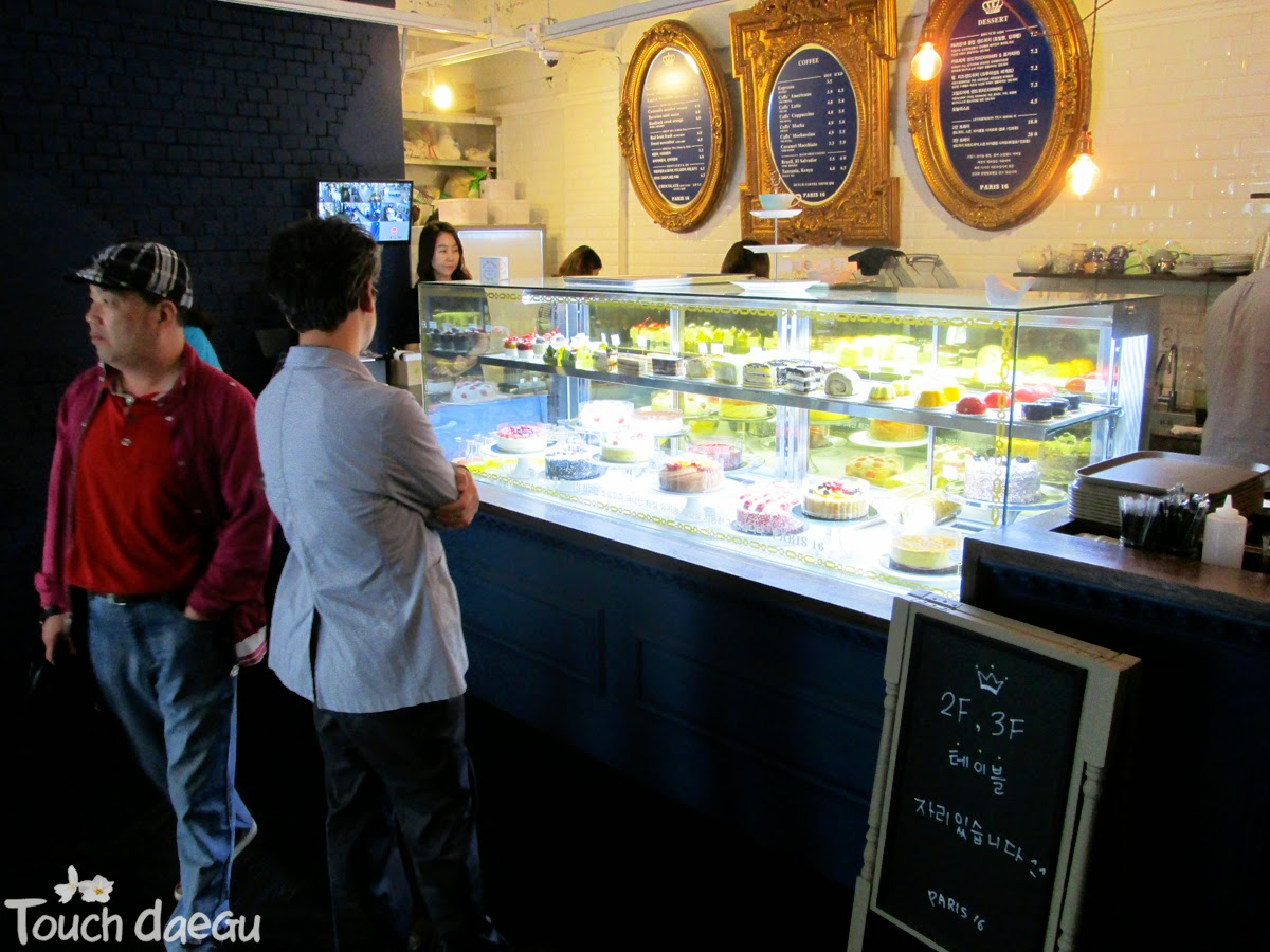 A customer is choosing sweets at the showcase