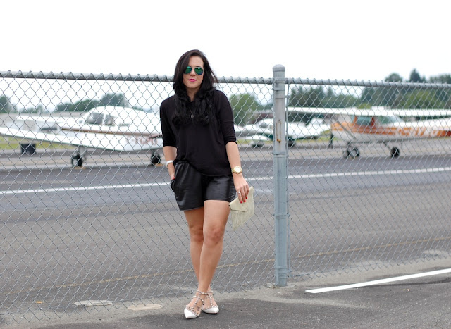 Valentino Rockstud flats, Topshop leather shorts and shirt and flash frame aviators.