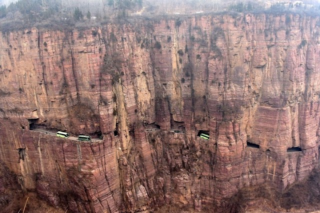 The road carved into the steep cliff of 200 m high